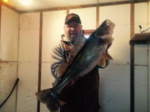 Tommy with 28 inch walleye