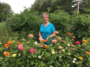 Diane behinds flowers